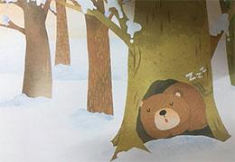 坐在蓝星星上的棕熊